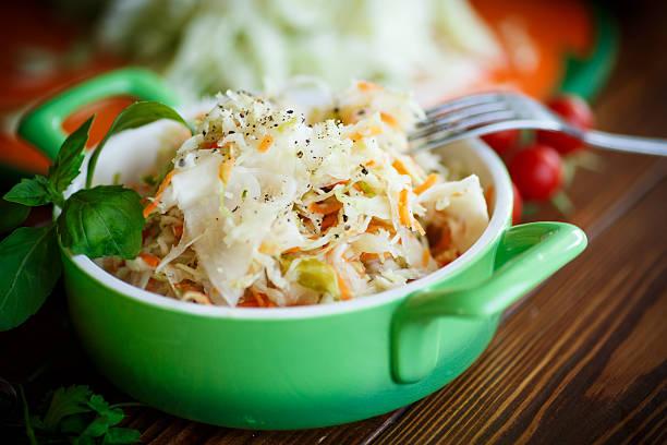 sauerkraut with carrots in a bowl - choucroute photos et images de collection