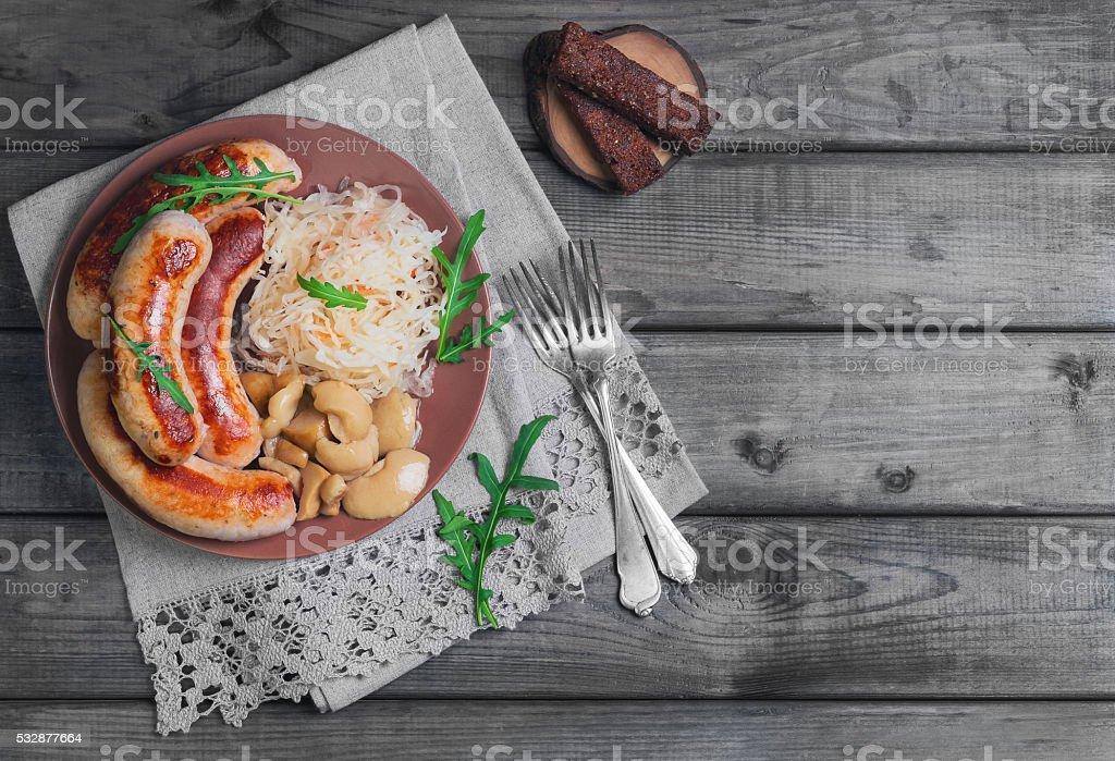 Sauerkraut with fried Munich sausages stock photo