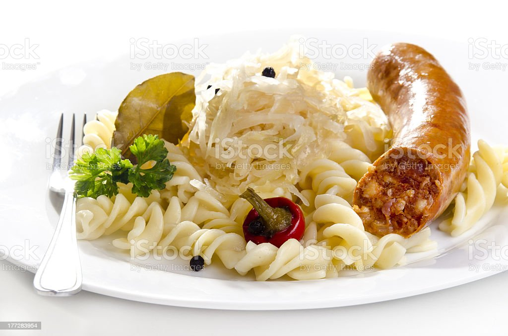 Sauerkraut with noodle and home made sausage royalty-free stock photo