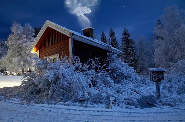 Sauna in winter moonlight stock photo
