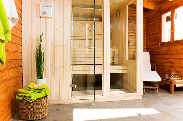 sauna image of a sauna cabin with resting area sauna stock pictures, royalty-free photos & images