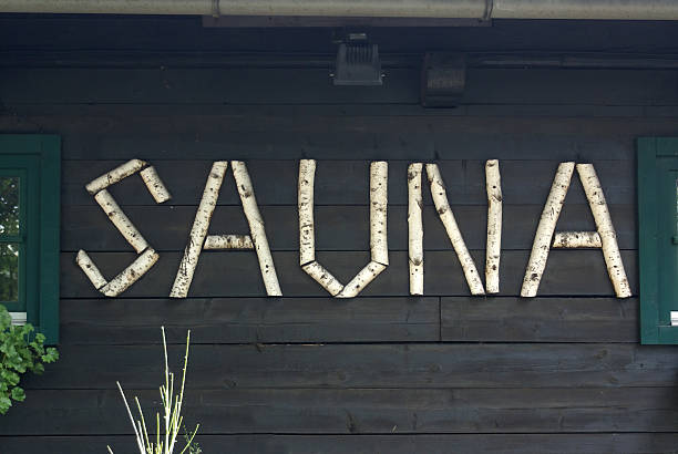 "SAUNA The word ""sauna"" written using birch branches at a sauna in Europe. davelongmedia stock pictures, royalty-free photos & images"