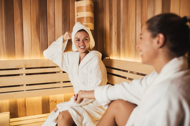 Sauna room Two beautiful young women relaxing in SPA sauna room. sauna stock pictures, royalty-free photos & images