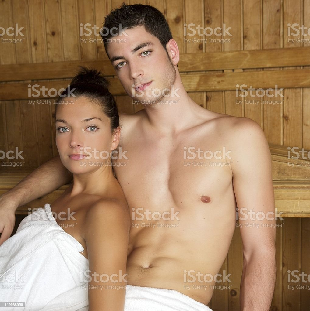 Sauna spa therapy young group in wooden room royalty-free stock photo