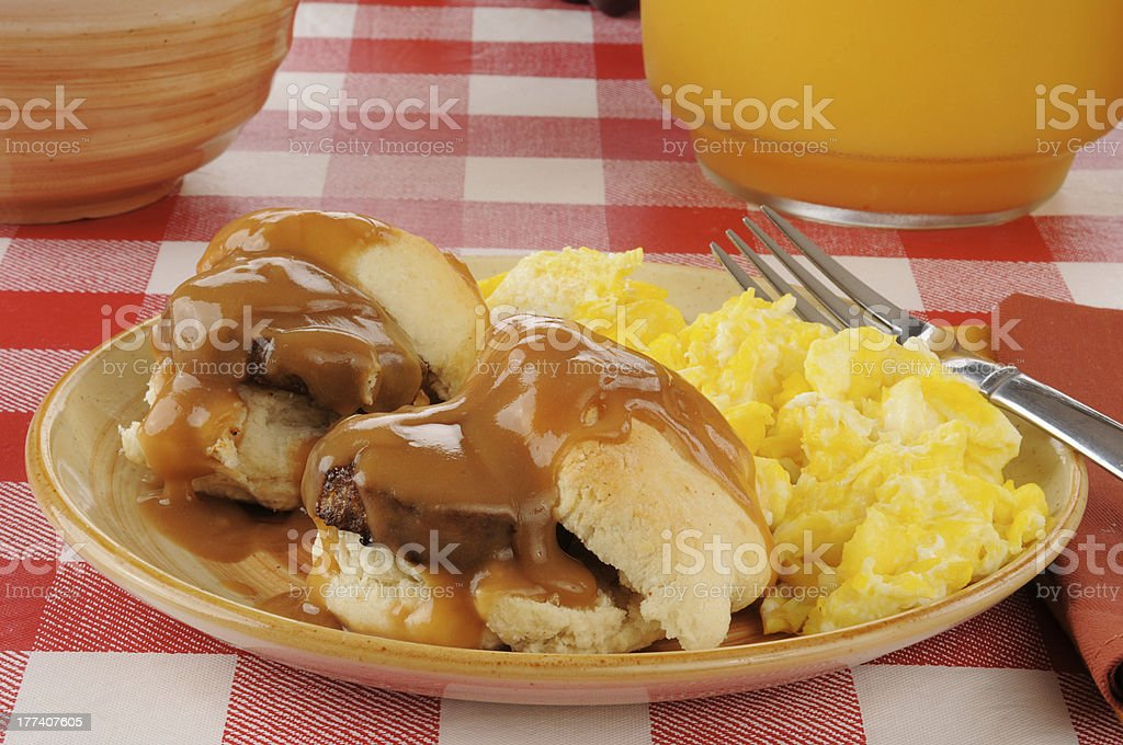 Sausage and biscuits with scrambled eggs stock photo