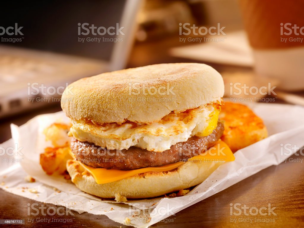 Sausage and Egg Breakfast Sandwich at your Desk bildbanksfoto