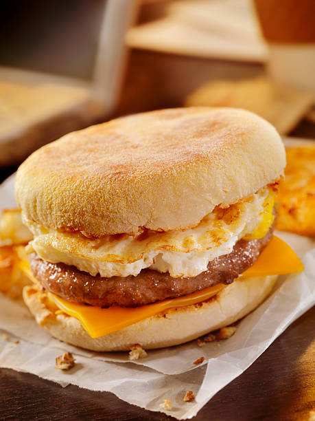 Sausage and Egg Breakfast Sandwich at your Desk stock photo