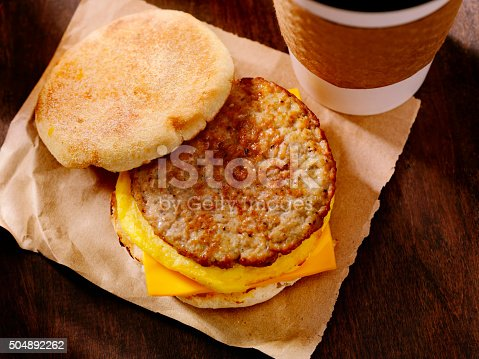Sausage, Egg and Cheese Breakfast Sandwich on a Toasted English Muffin with a Take Out Coffee- Photographed on Hasselblad H3D2-39mb Camera