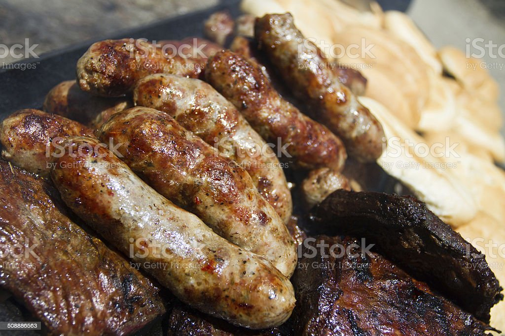 BBQ sausage and meat with bread stock photo