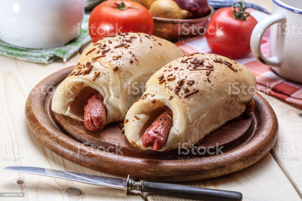 Sausage baked in dough. stock photo