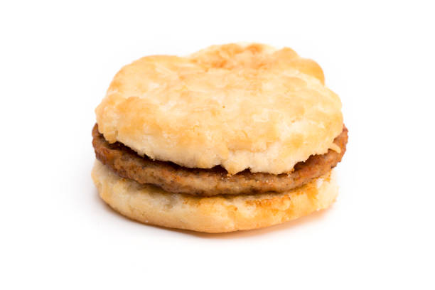 Sausage Biscuit Breakfast Sandwich on a White Background Breakfast Sandwich on a White Background biscuit stock pictures, royalty-free photos & images