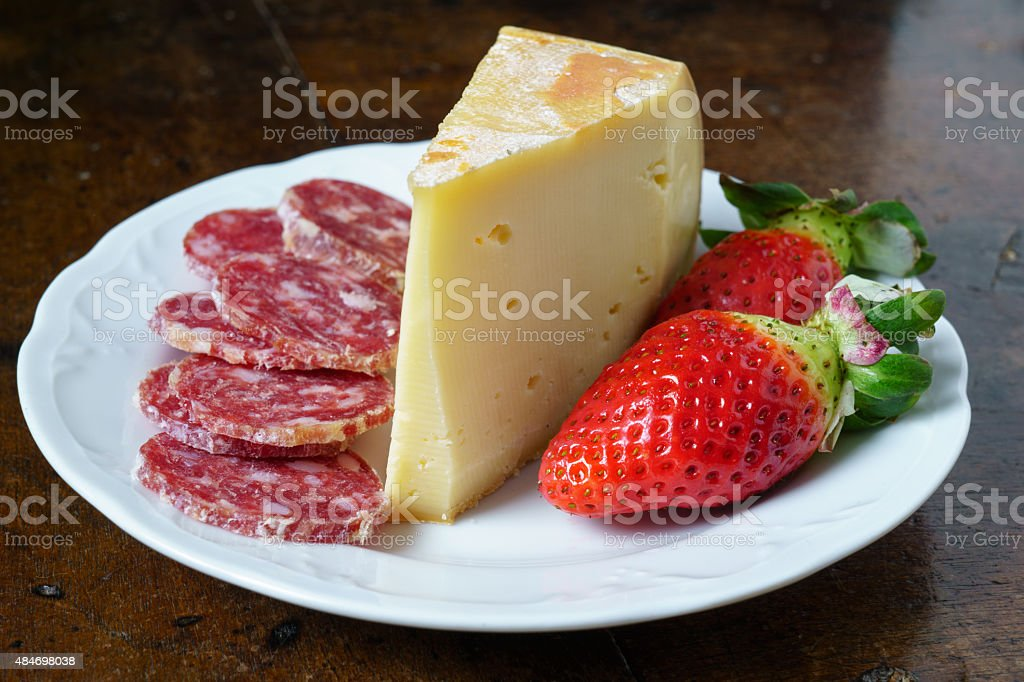 sausage fontina and strawberries in the pot stock photo