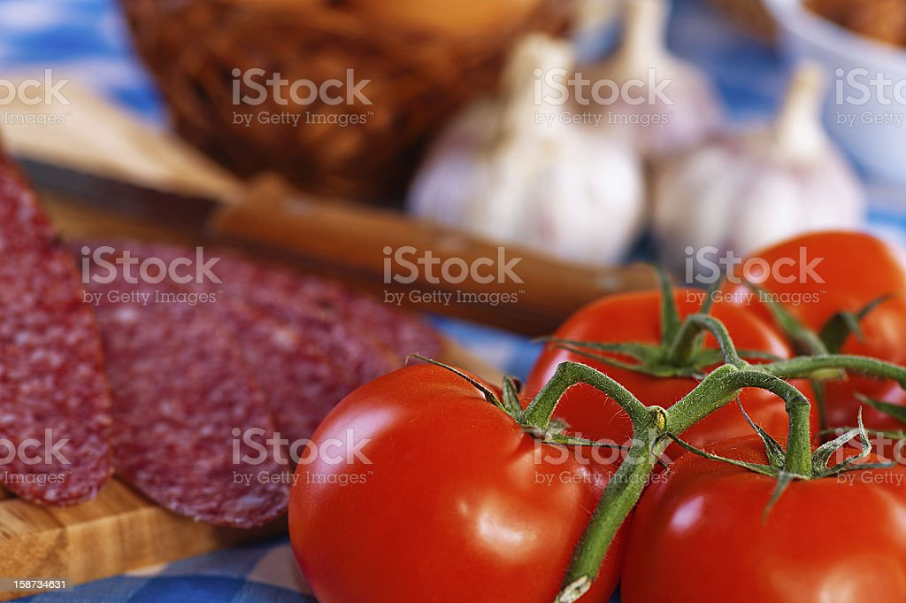 sausage (salami), garlic, tomato branch, eggs royalty-free stock photo
