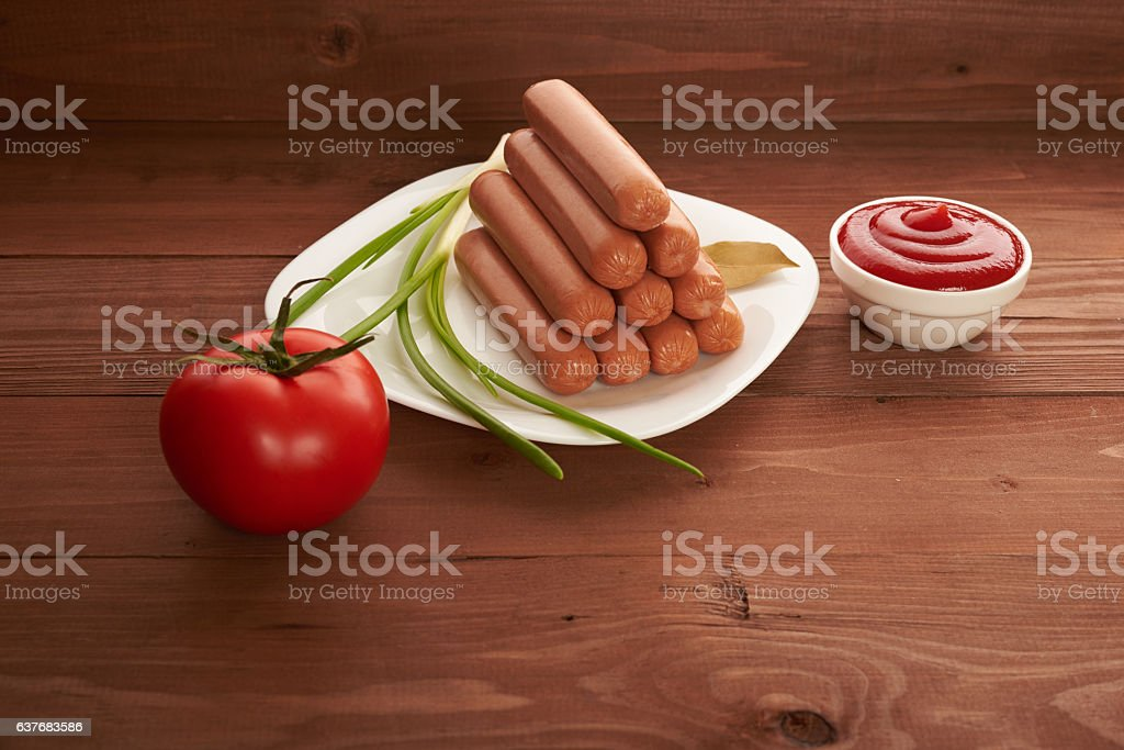 sausage on a white plate stock photo