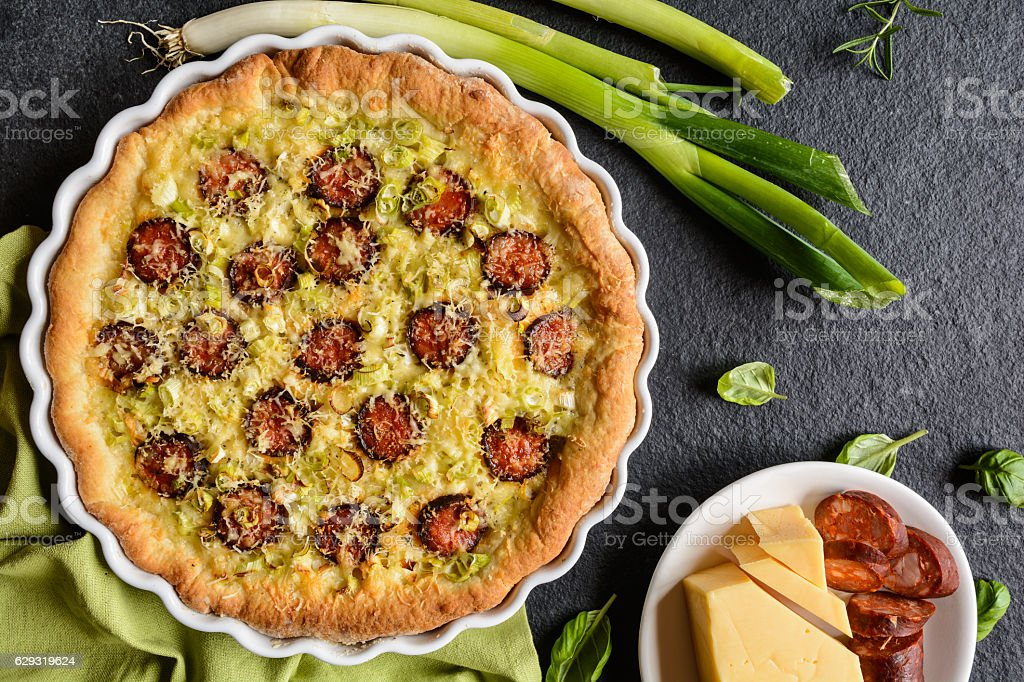 Sausage pie with green onion and cheese stock photo