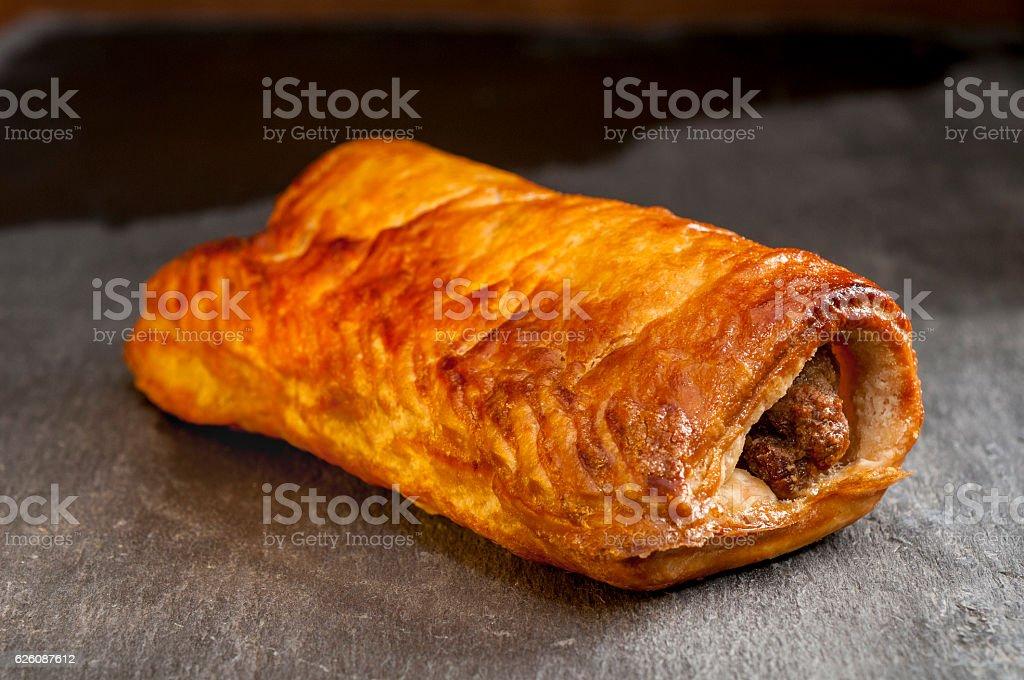 Sausage Roll on Slate stock photo