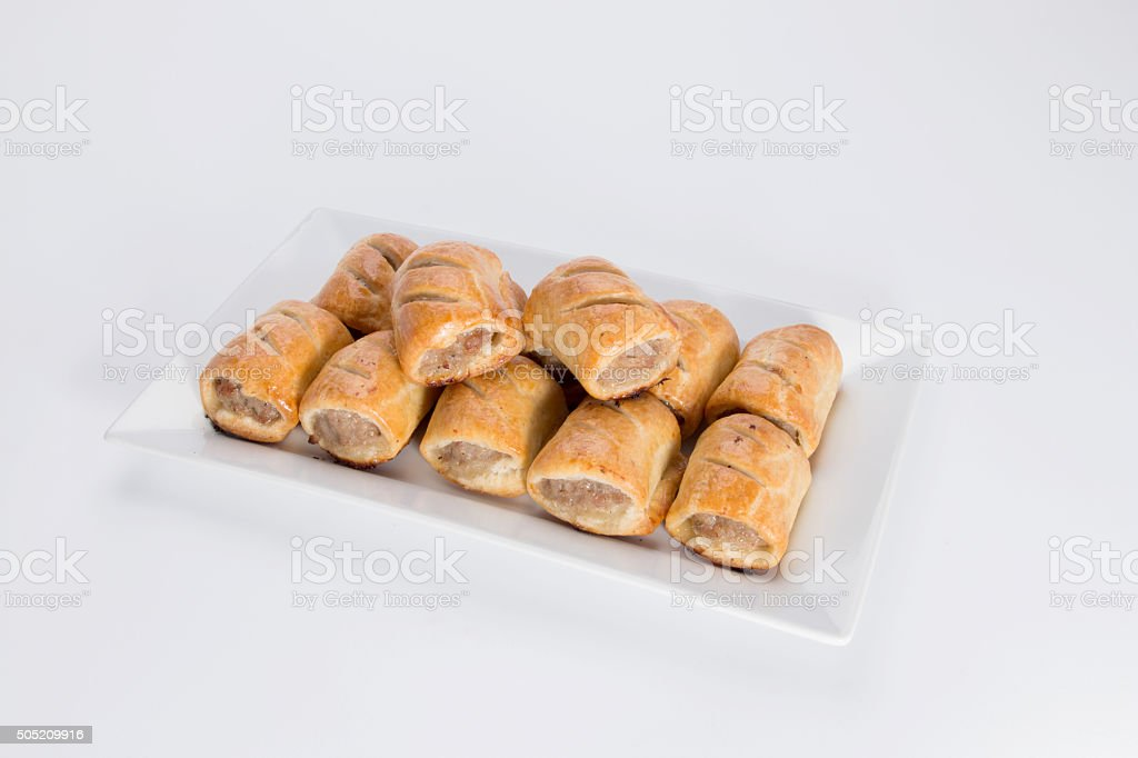 Sausage rolls, on a white plate stock photo