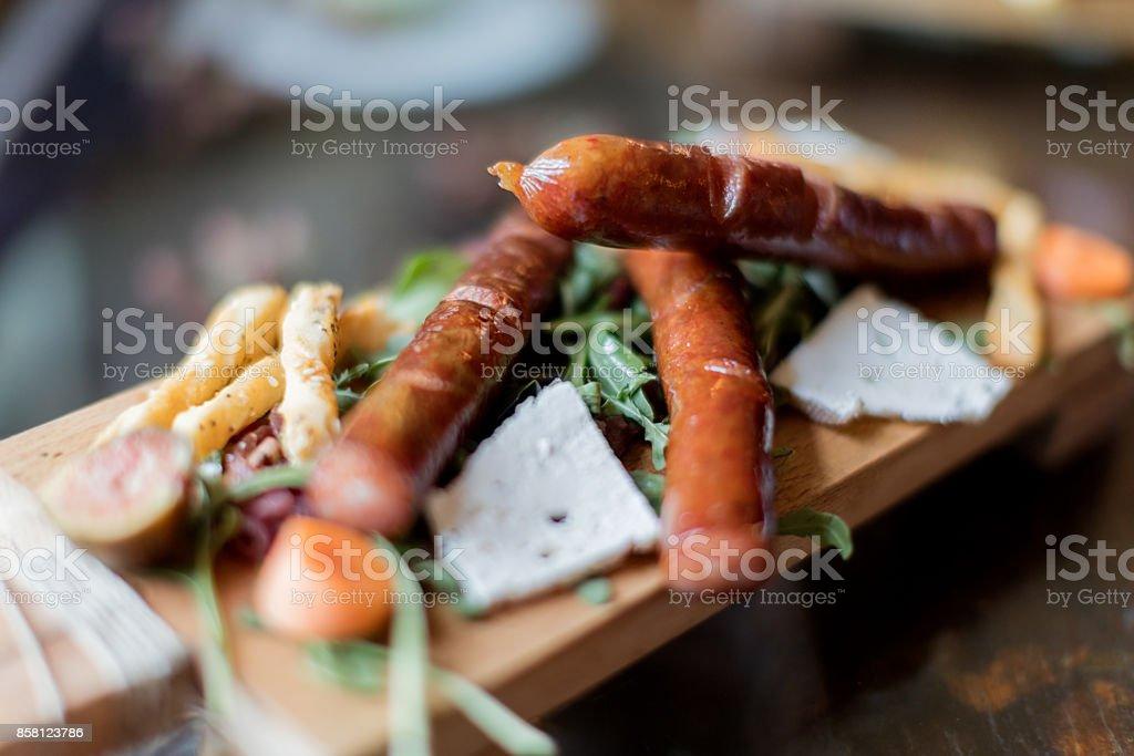 Sausage served on plank stock photo