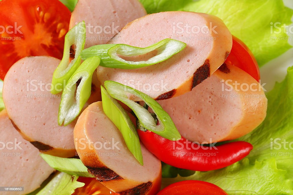 sausage slices with vegetables royalty-free stock photo