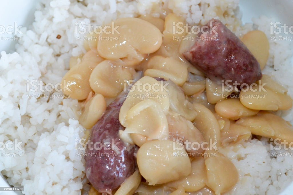 Sausage with tomato sauce with Mauritian Lima Beans Curry (Masala Gros Pois) with white rice stock photo