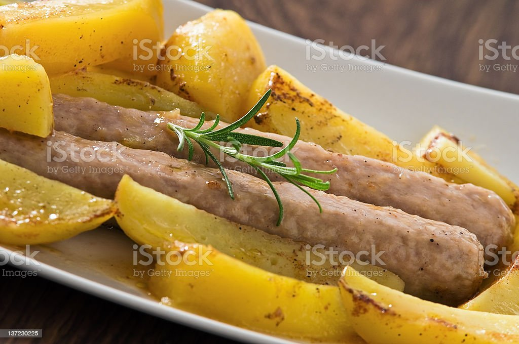 Sausages and potatoes. royalty-free stock photo