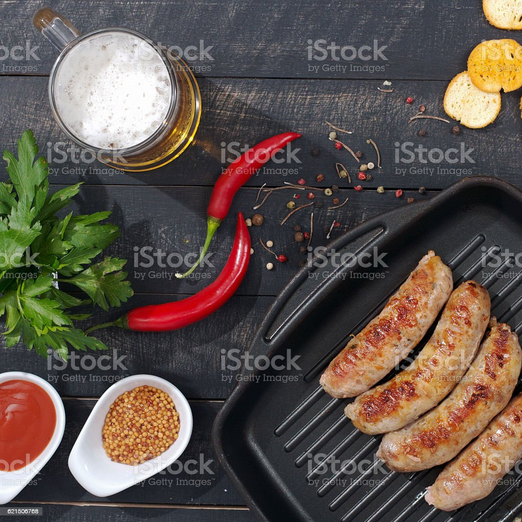 Sausages, Beer and Snack on the wooden backdround. Top view. Lizenzfreies stock-foto