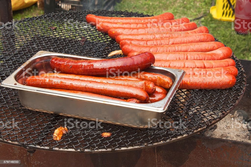 Sausages cooking on the grill stock photo
