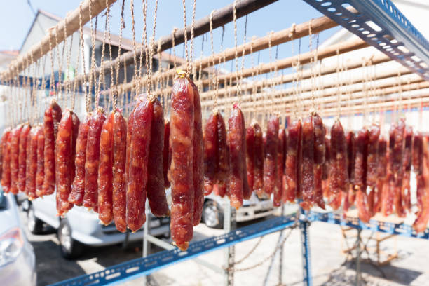 Sausages hanging from string stock photo