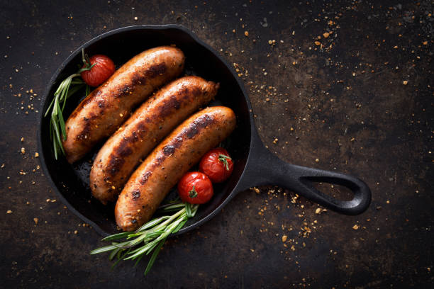 Sausages in a skillet stock photo