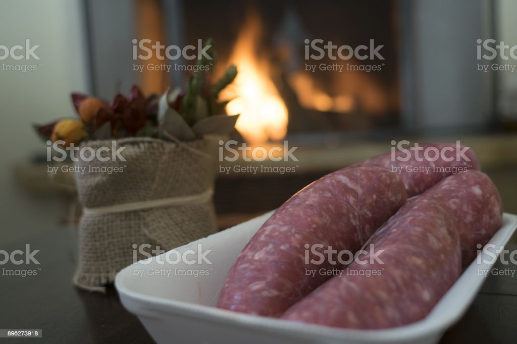 sausages in front at the fireplace stock photo