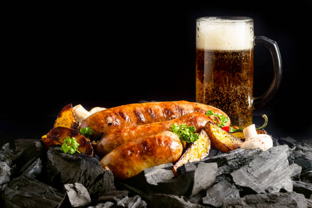Sausages on coals stock photo