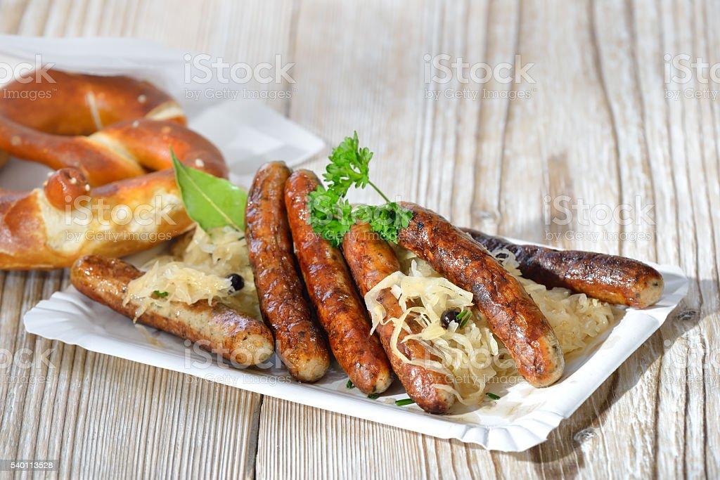Sausages on sauerkraut stock photo