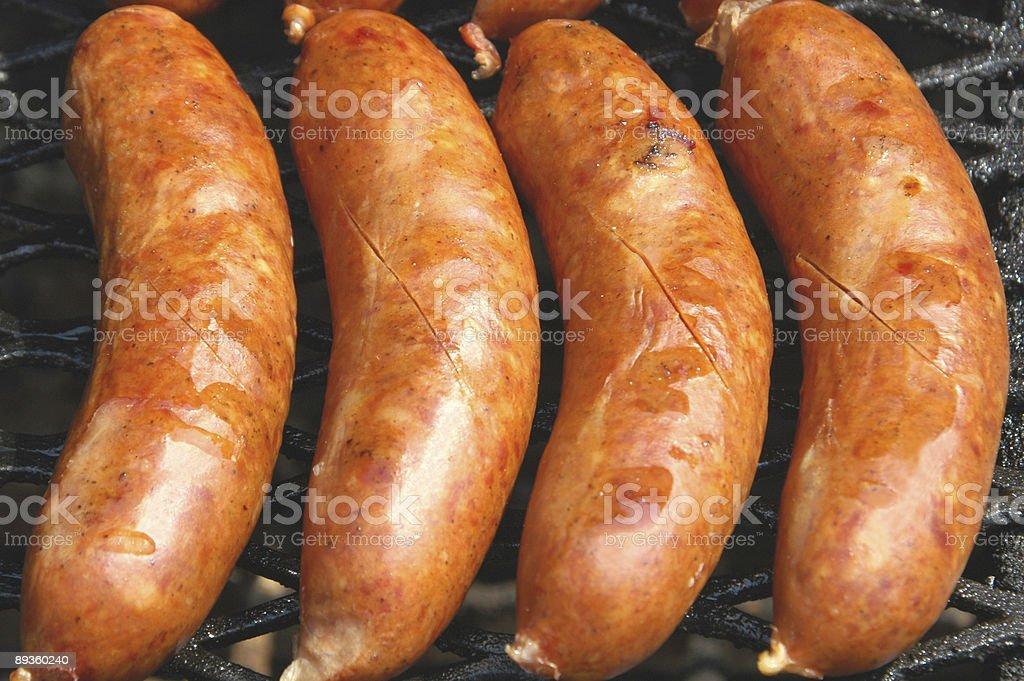 Sausages on the grill royaltyfri bildbanksbilder