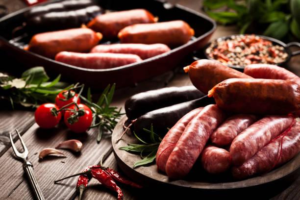 Sausages variation on dark wood table stock photo