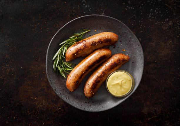Sausages with dijon mustard sauce and seasoning stock photo