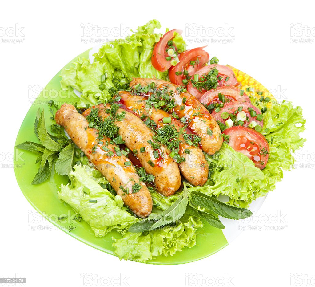 sausages with lettuce leaves royalty-free stock photo
