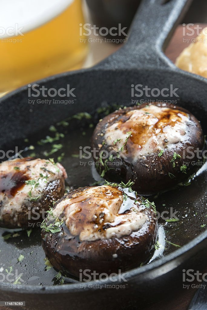 Sautéed mushrooms filled with cheese royalty-free stock photo