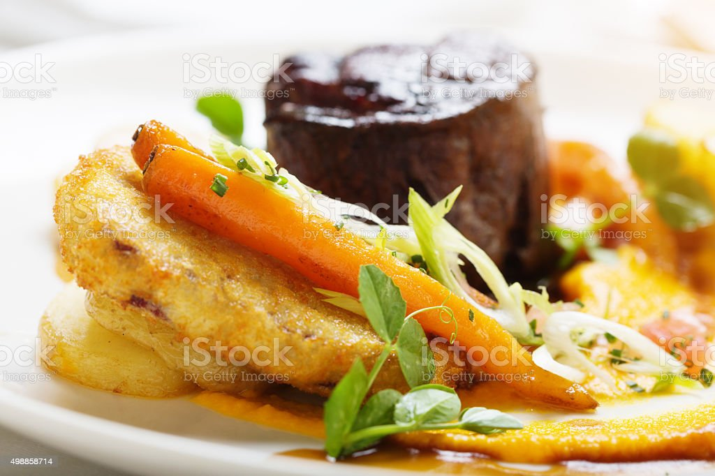Saute potatoes and grilled fillet steak make a memorable meal stock photo