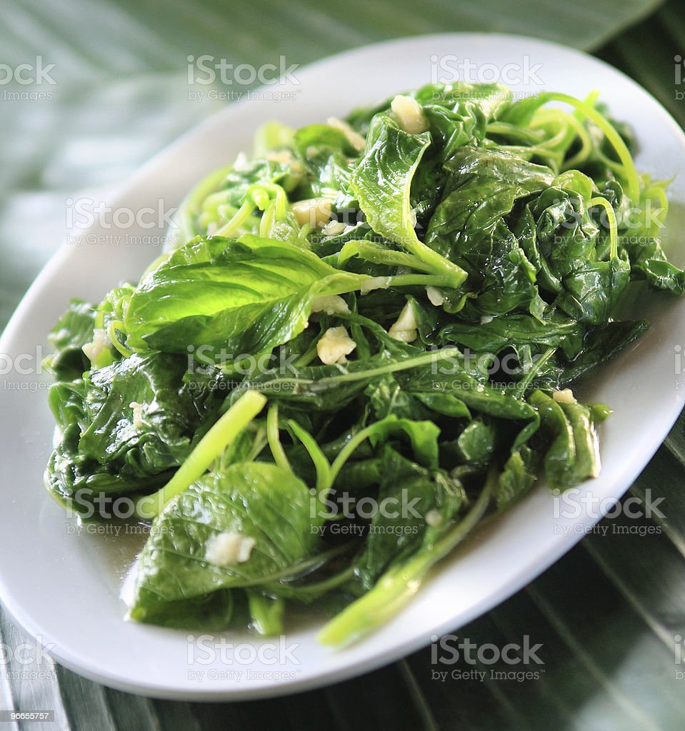 Sauteed garlic spinach stock photo