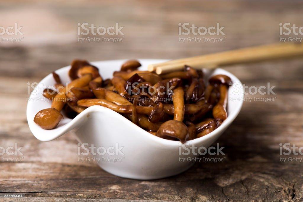 sauteed japanese bunapi-shimeji mushrooms stock photo