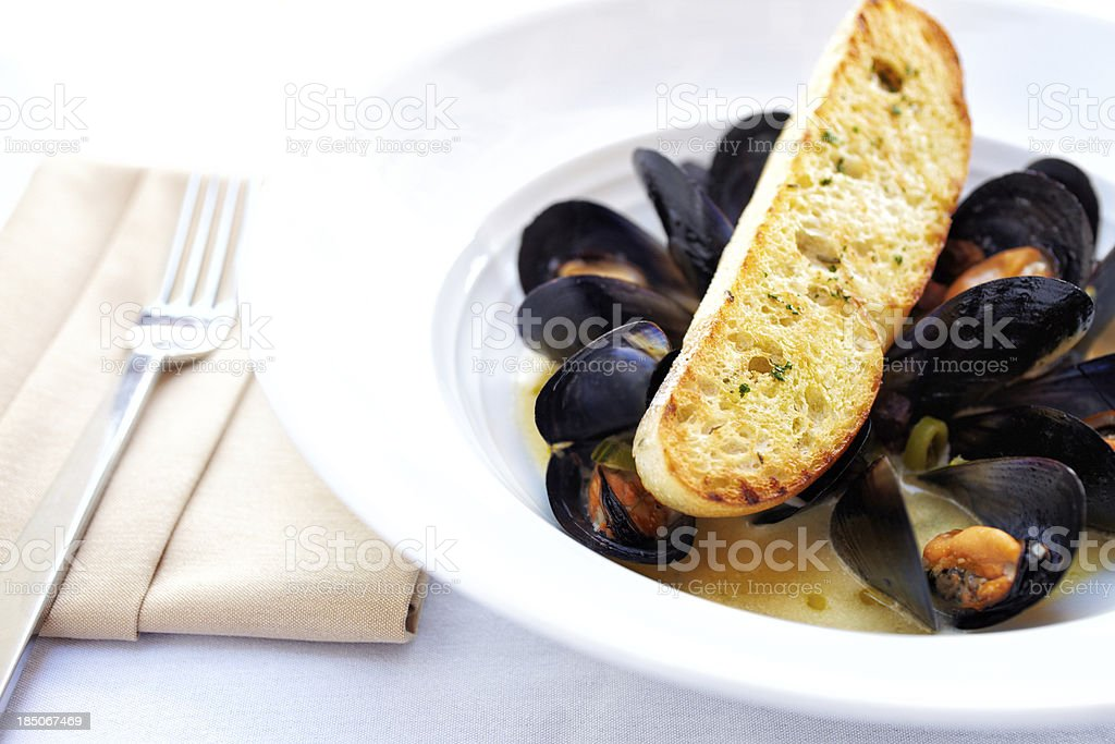Sauteed muscles, english peas and parmesan crostini stock photo