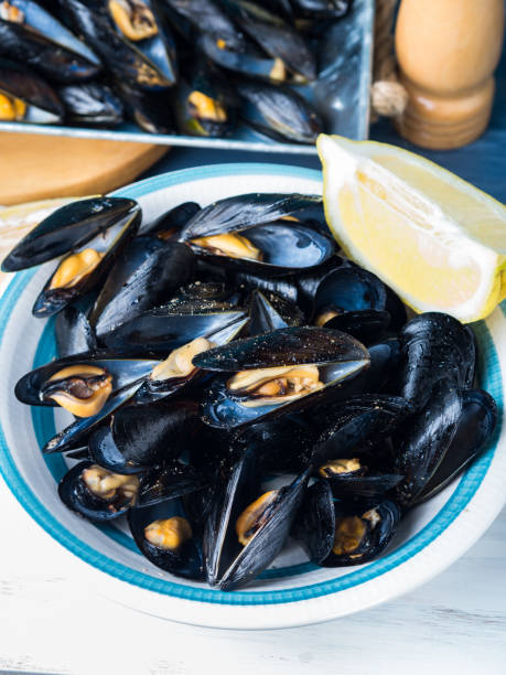 Sauteed mussels with black pepper and lemon stock photo
