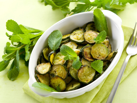Sauteed zucchinis with mint leaf