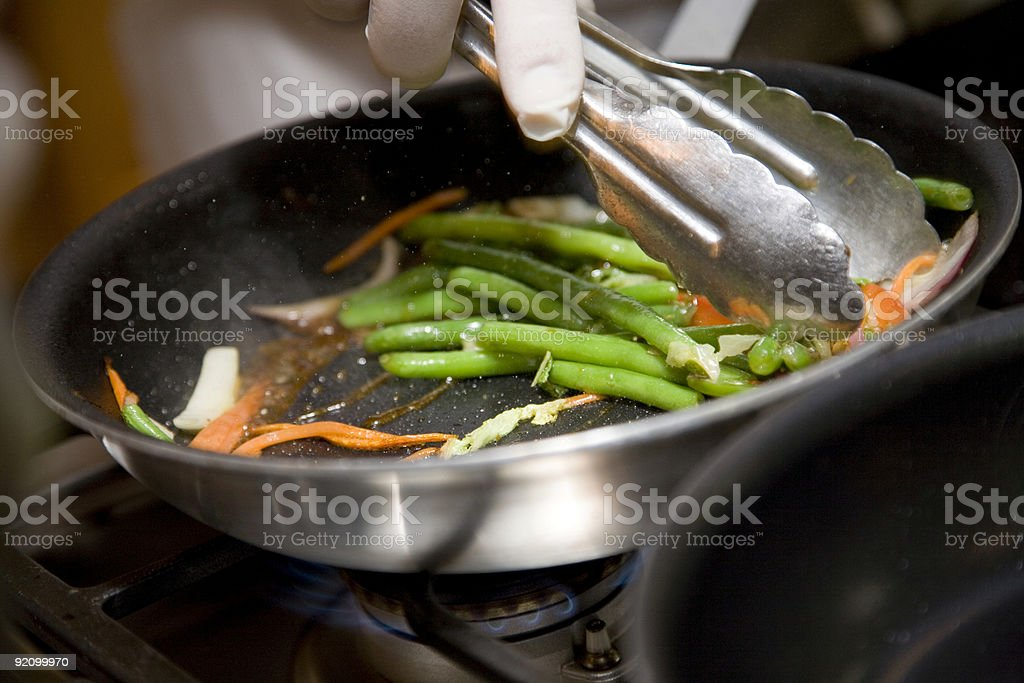 Sauteing Green Beans and Carrots stock photo
