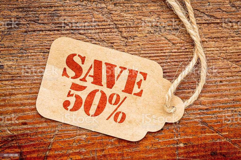 save 50 percent sign  on a price tag stock photo
