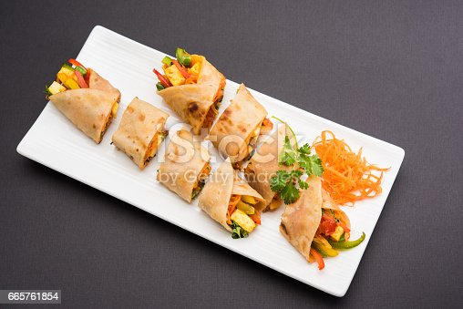 istock Save Download Preview Indian popular snack food called Vegetable spring rolls or veg roll or veg franky made using paneer or cottage cheese and vegetables wrapped inside paratha/chapati/roti with tomato ketchup. 665761854
