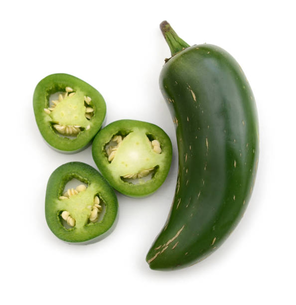 Save Download Preview Pile of green Jalapeno pepper slices crosswise seeds removed Pile of green Jalapeno pepper slices crosswise seeds removed jalapeno pepper stock pictures, royalty-free photos & images