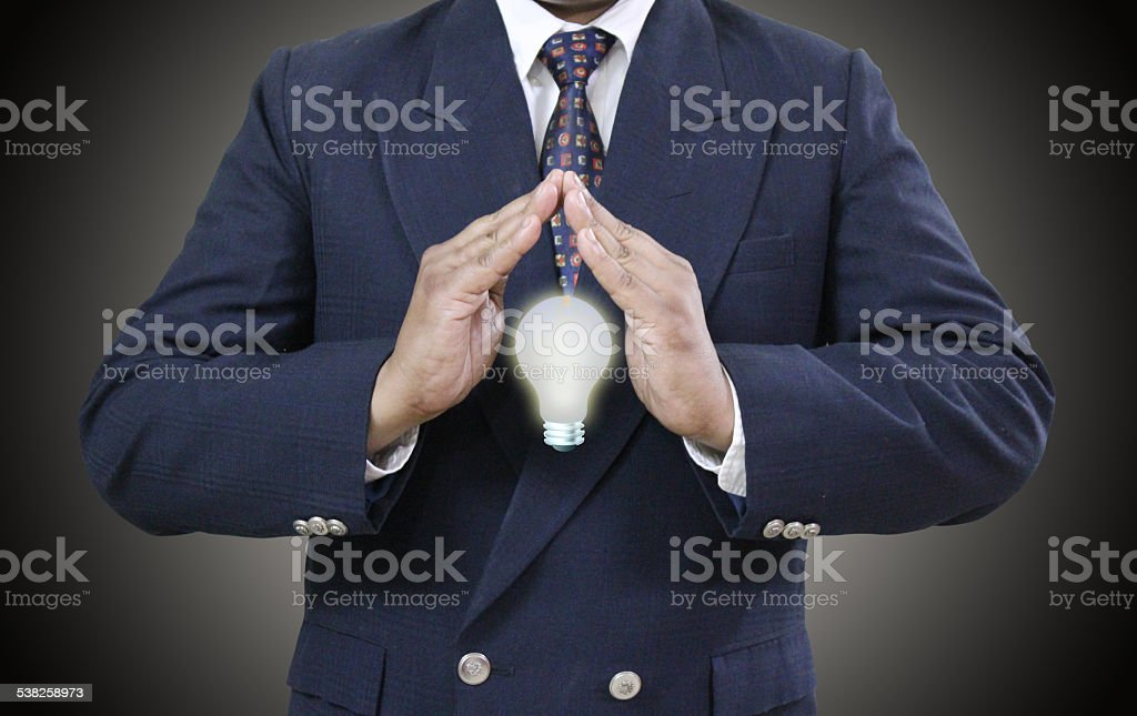 Well Dressed man Showing Save electricity under both hands as...
