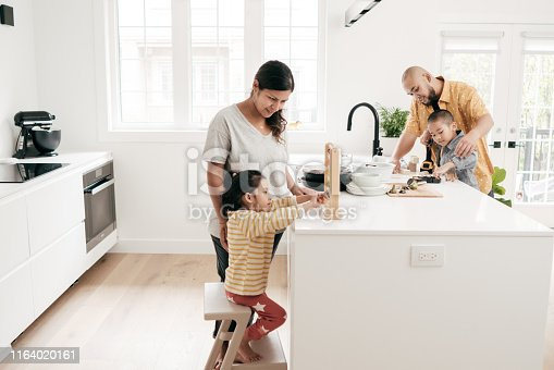Family in  the kitchen with kids