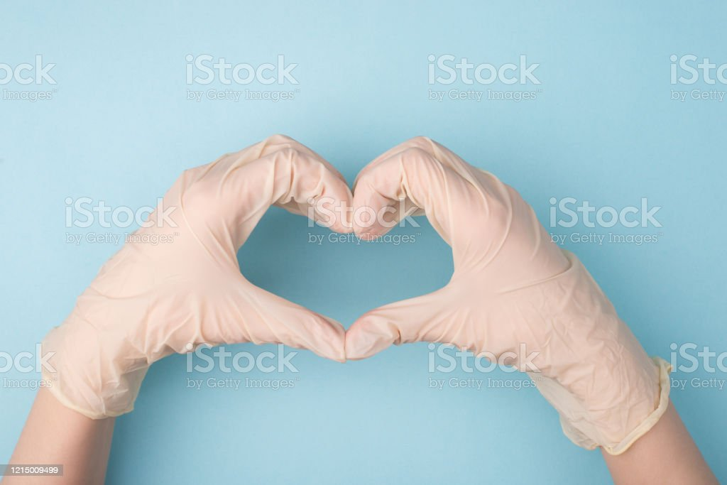 Save life concept. Cropped top above overhead close up photo of hands making giving shape of heart with fingers isolated over blue background Save life concept. Cropped top above overhead close up photo of hands making giving shape of heart with fingers isolated over blue background Adult Stock Photo